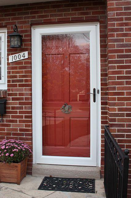 Red Paneled Door With A Storm Door Front Door Colors