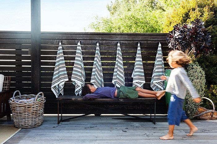 At Home With Designer Claire Stansfield In 2020 Pool Towels Towel Rack Pool Outdoor Pool
