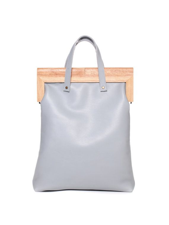 8a7b88d99b40 Woodframe handbag - Crafted with a wooden self-clasping frame