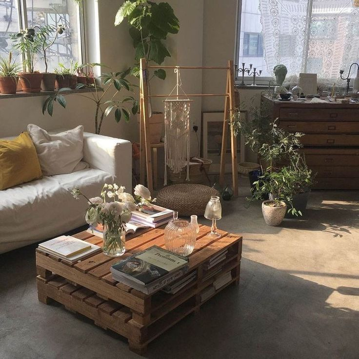 Photo of minimalist plant inspired living room, white leather couch
