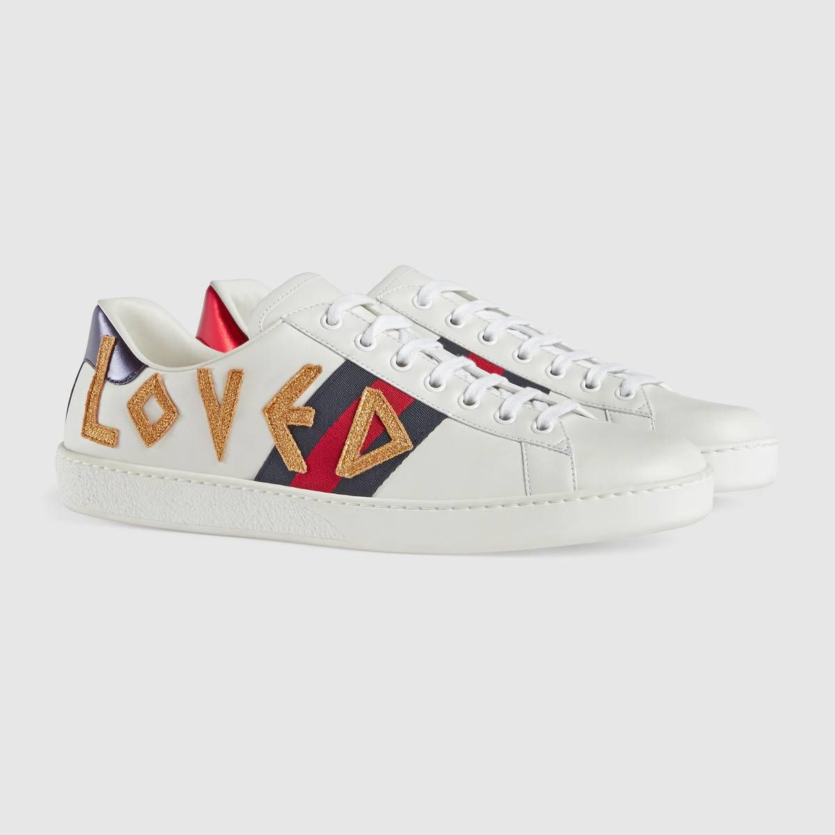 46030c94eeb Shop the Ace embroidered sneaker by Gucci. The retro inspired design of the Ace  sneaker is embellished with an embroidered Loved appliqué along the  sides—an ...