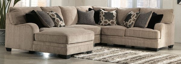 The contemporary Katisha Sectional by Ashley Furniture in a taupe
