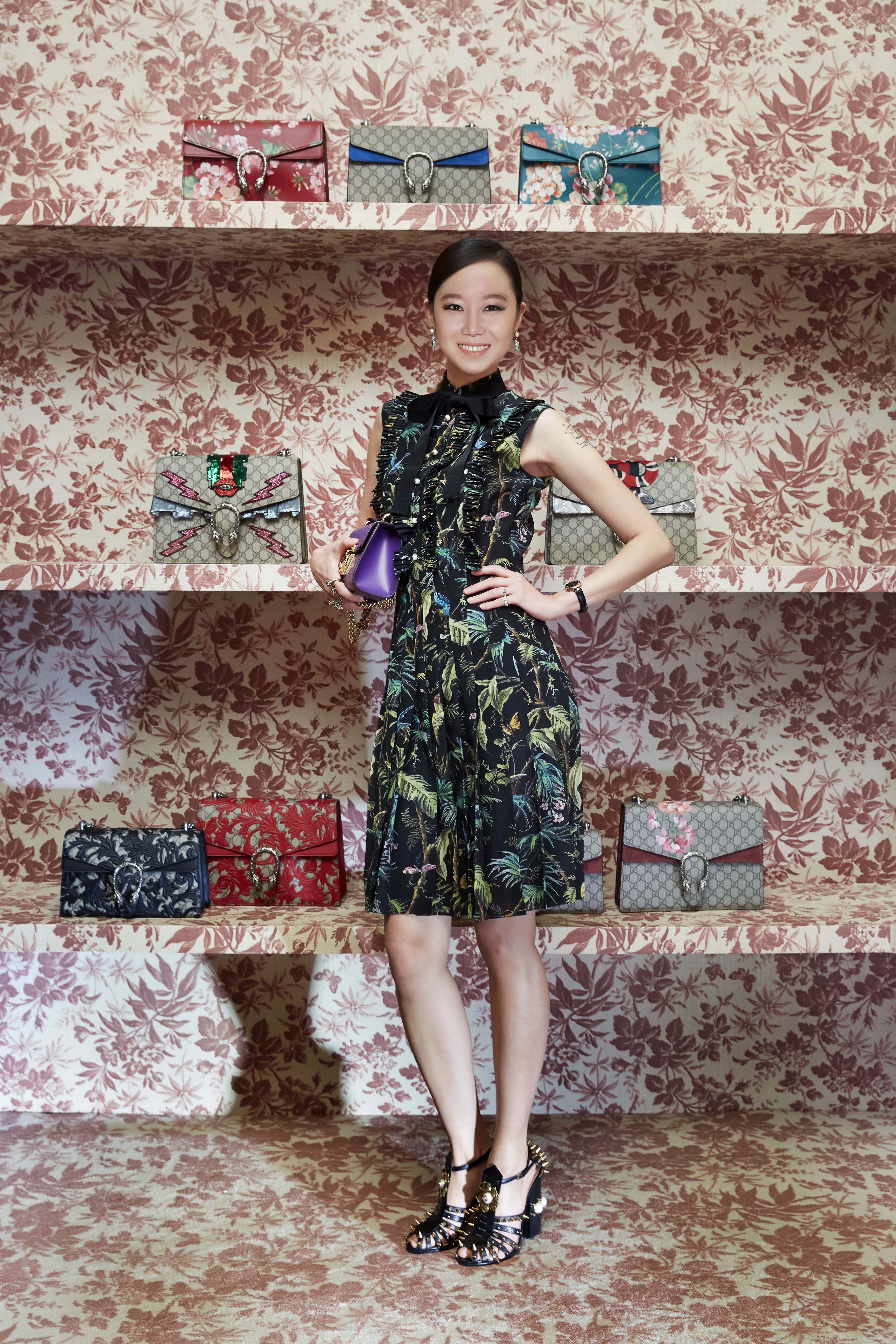 f5ff58ed12b Actress Gong Hyo-Jin in a Gucci Pre-Fall 2016 tropical print dress and  pearl and spike embellished sandals.