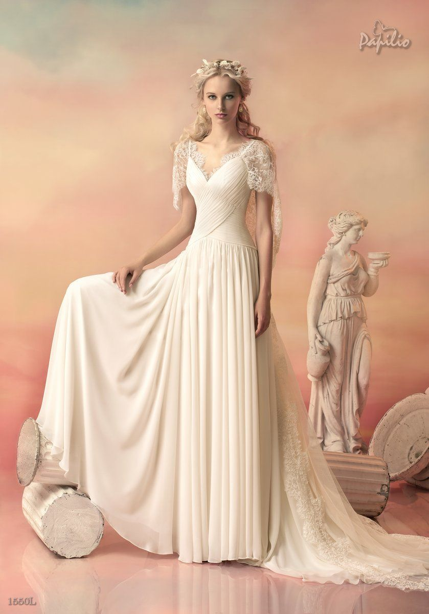 Strut in confident in a goddess inspired wedding gown with a touch