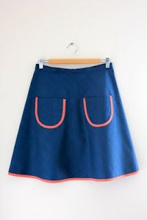 Love, love this simple quarter circle skirt trimmed with a red stripe bias.