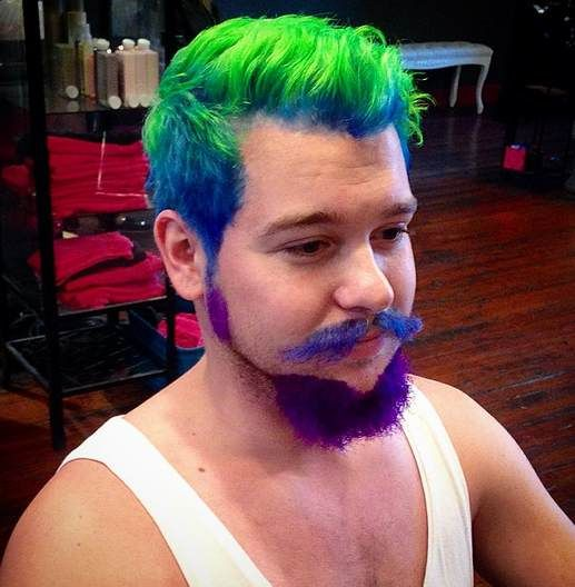 A Barbershop Photograph Of Hipster Guy With Green Colored Hair And Blue Beard