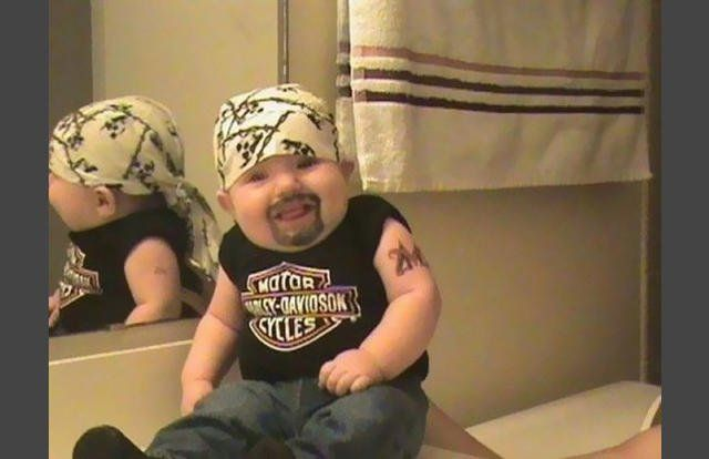 biker baby 29 Hilarious Halloween Photos Of Costumed Kids Who Won At - ridiculous halloween costume ideas