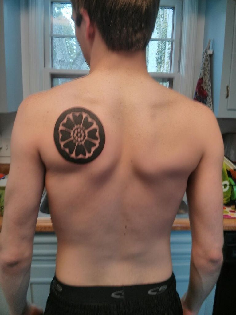 My first tattoo it 39 s a symbol for a white lotus credit for White lotus tattoo