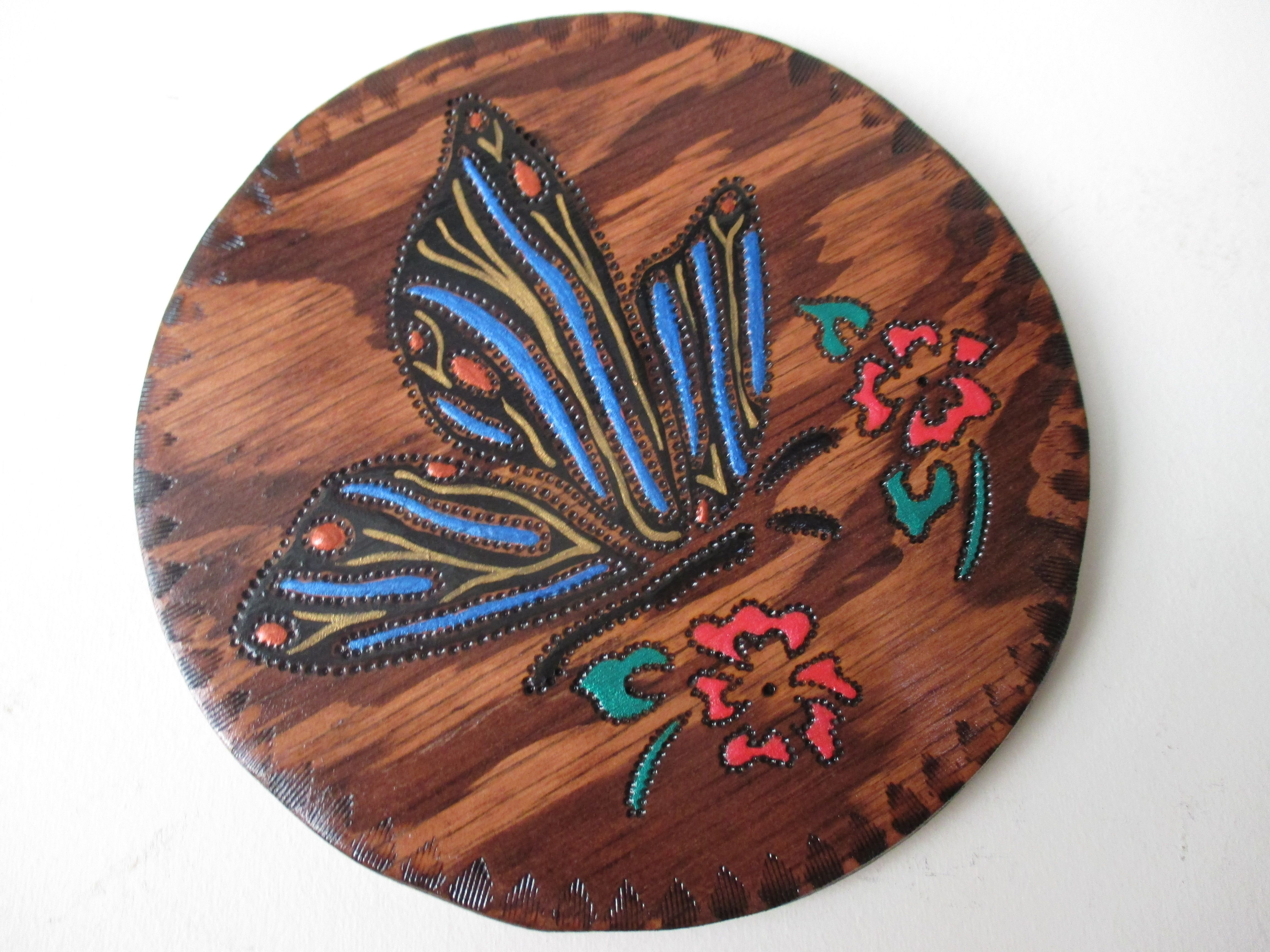 Wood Burned Butterfly hanging around some flowers