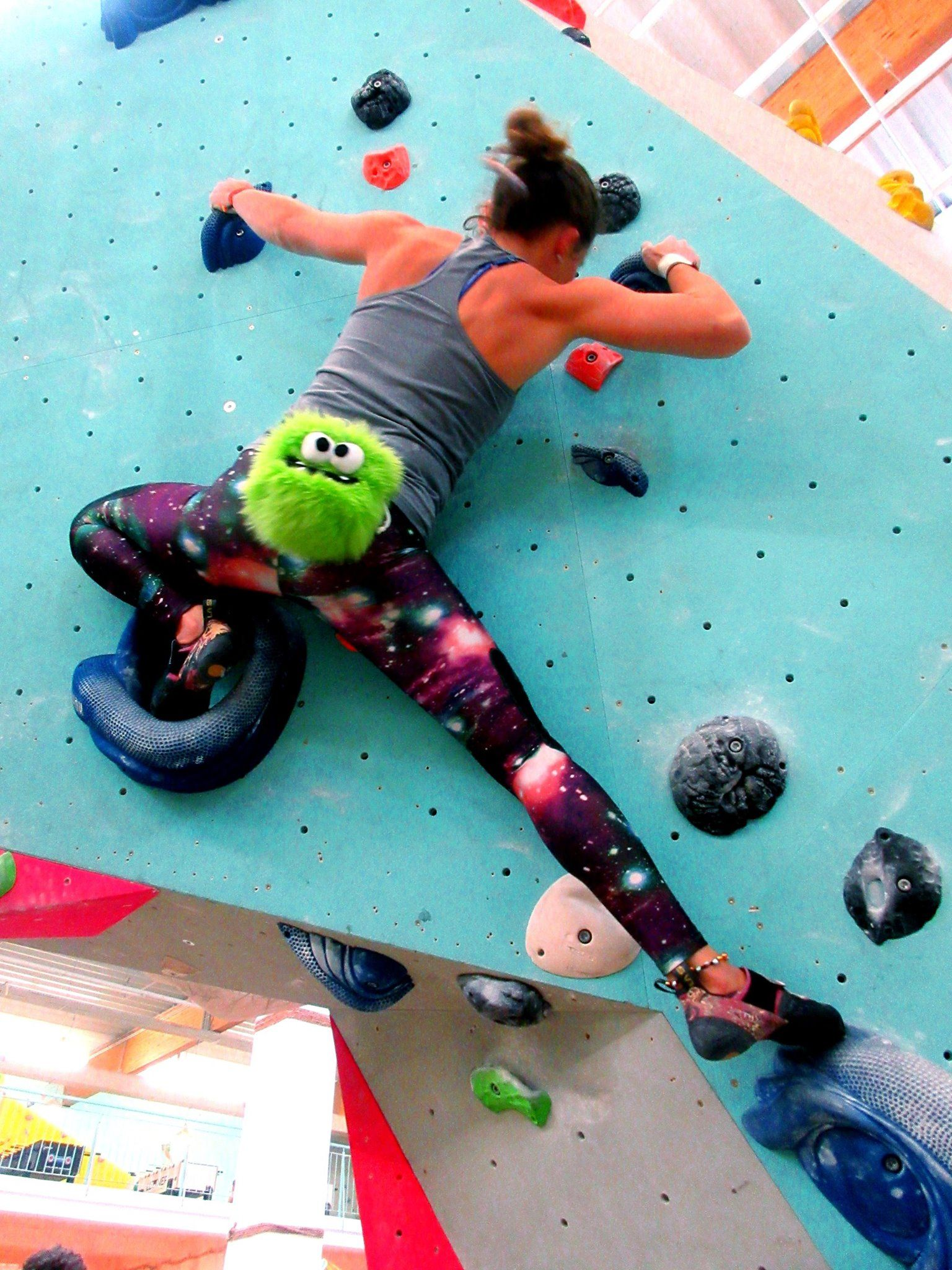 daniela schmidt climbing with green five toothed monster funny rock