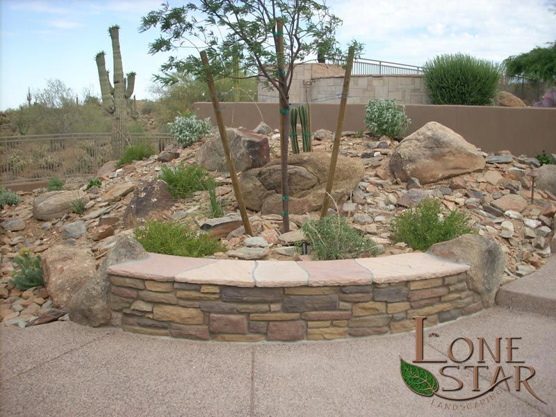 Seat Wall With Stacked Stone Facing And Flagstone Top In A Desert Landscape Scottsdale