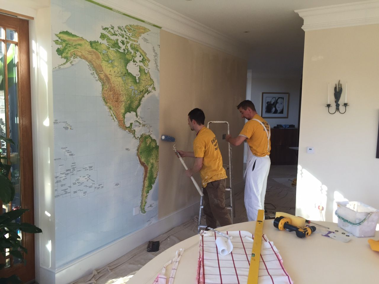 action shot of our wonderful world map wallpaper being installed world map. Black Bedroom Furniture Sets. Home Design Ideas