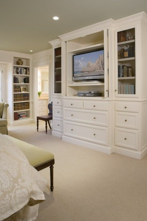 Master Bedroom built ins facing bed w/ cabinet for hiding tv. I LOVE the  built in storage space! Looks so nice!