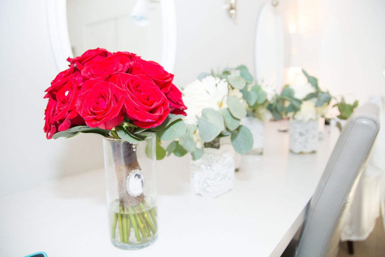 Denver wedding. Red rose bouquet. White bridesmaid bouquets