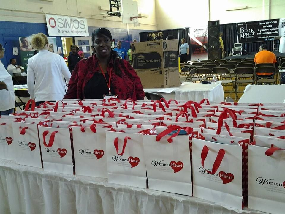 Patty LaVelle Farmer, WomenHeart Champion, distributes Red