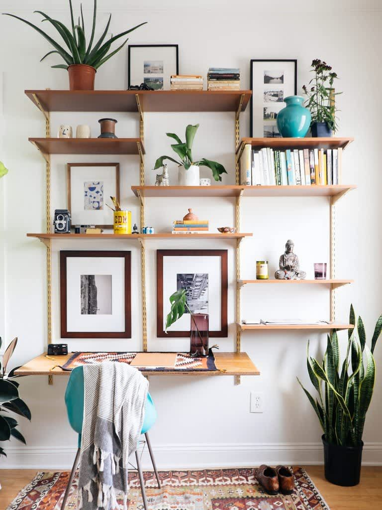 It Can Be Done: 8 Spaces that Make Track Shelving Look Good | Desk wall  unit, Living room diy, Mid century desk