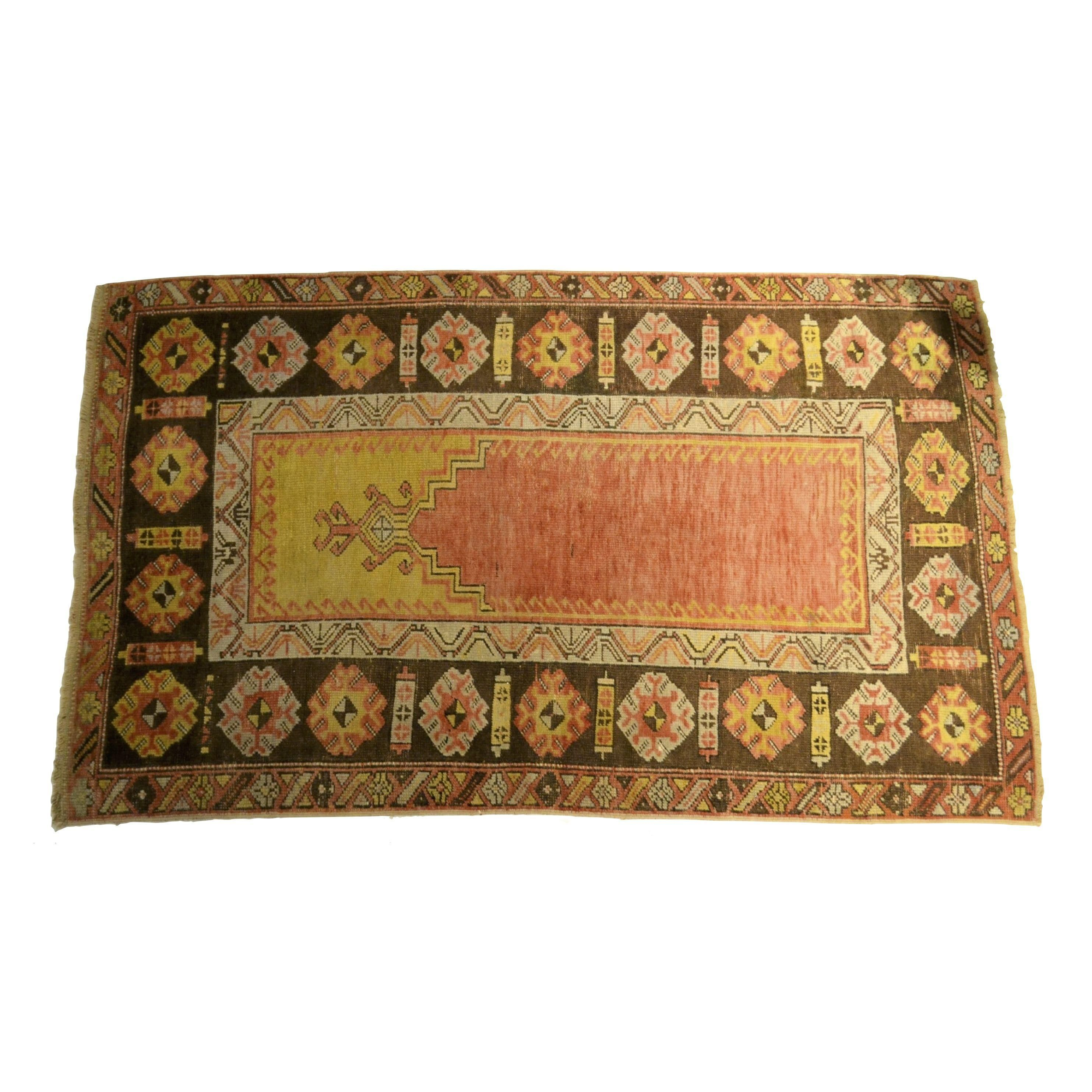 A vintage Turkish prayer rug in tones of brown and yellow. Age 60+ years.