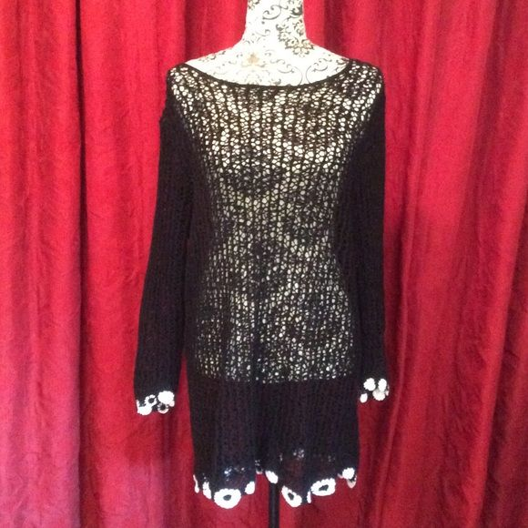 Gorgeous knitted 100% cotton tunic. Black with white flowered accents at hem and sleeves. See through so you'd need a cami underneath. Wear with jeans, shorts or put a slip underneath and wear as a dress. Gorgeous!  Never worn! MANDAL BAY Tops Tunics