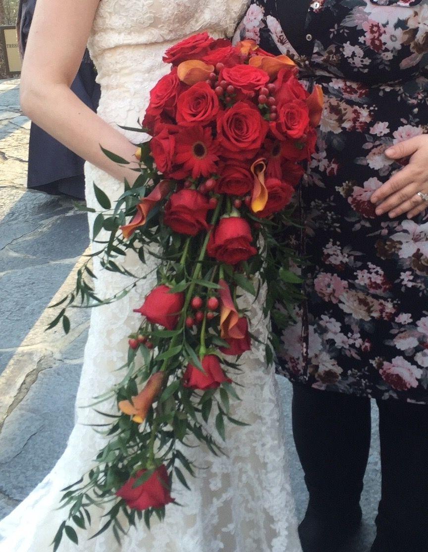 Winter wedding trailing red bouquet