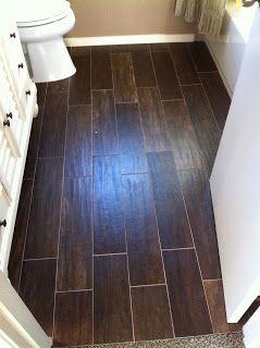 looks like hand-scraped woodtiles. | wood like tile