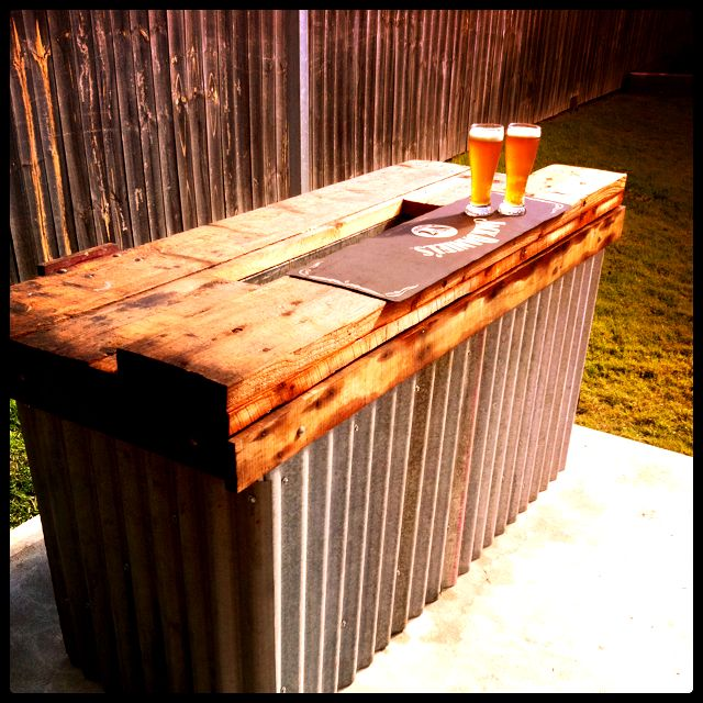 Rustic Bar with built in ice box - Hmmm...we might just have to build one of these for the pavilion!