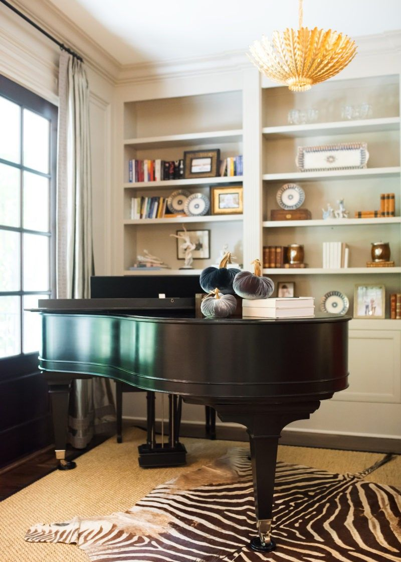 Elegant great room with grand piano, leather seating ...