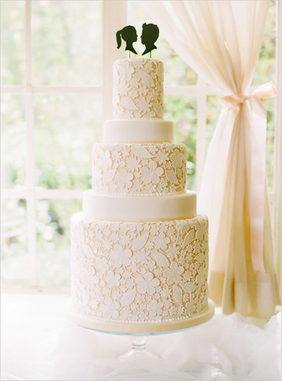 lace inspired cake with silhouette cake topper