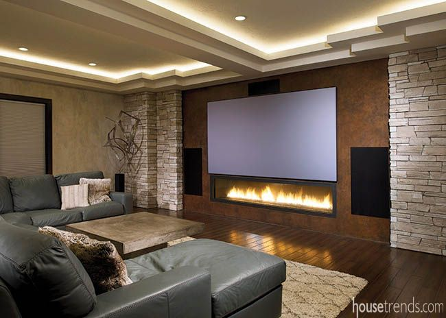 lighting fireplace. this home theater design includes rope lighting in the ceiling and a large contemporary fireplace placed