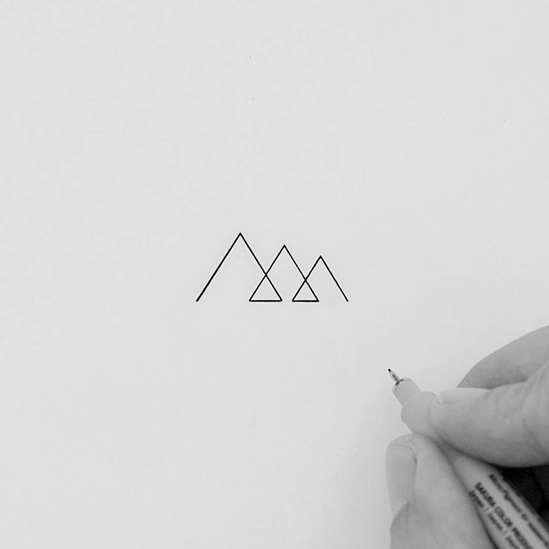 Photo of Super minimal and tiny mountains made in one single stroke. I'll maybe get it as…