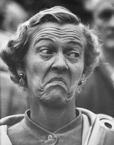 Mrs. Leland S. McCleery watches her Michigan Wolverines lose to the Wisconsin Badgers, 1959.