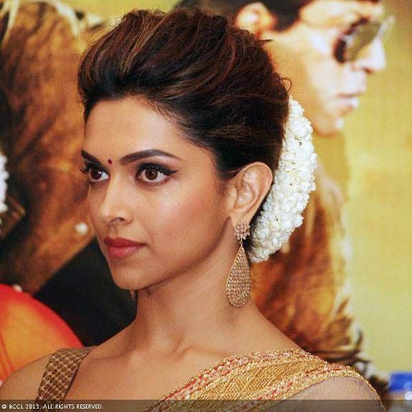 Deepika's hairstyle - classic indian bun with a gajra | Wedding bun hairstyles, Indian wedding ...