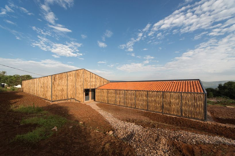sharon davis design uses handmade bricks and eucalyptus to form housing in rwanda