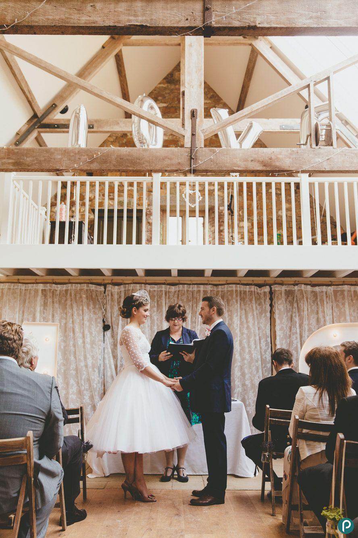 Rustic barn wedding in Dorset | Symondsbury Estate | 50's styled bride wedding outfit | Paul Underhill Photography