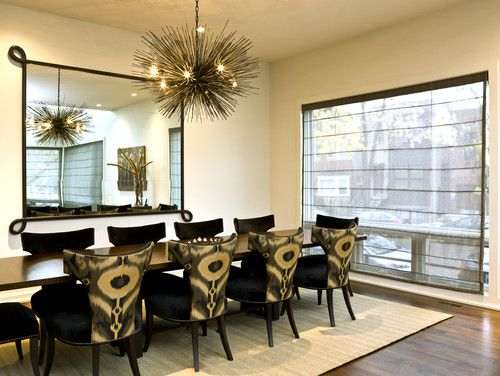 Modern Upholstered Dining Room Chairs lend drama to a neutral room. in plain black, these chairs might