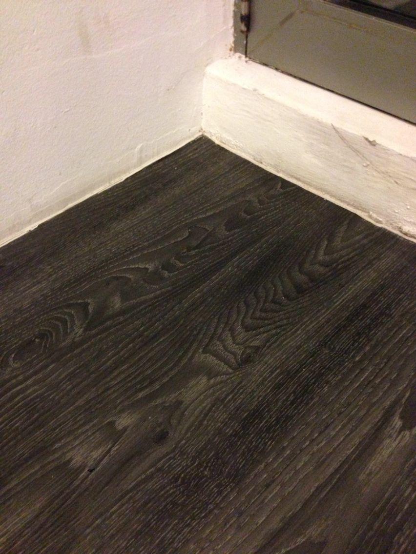 Vinyl linoleum flooring in dark wood texture  For the