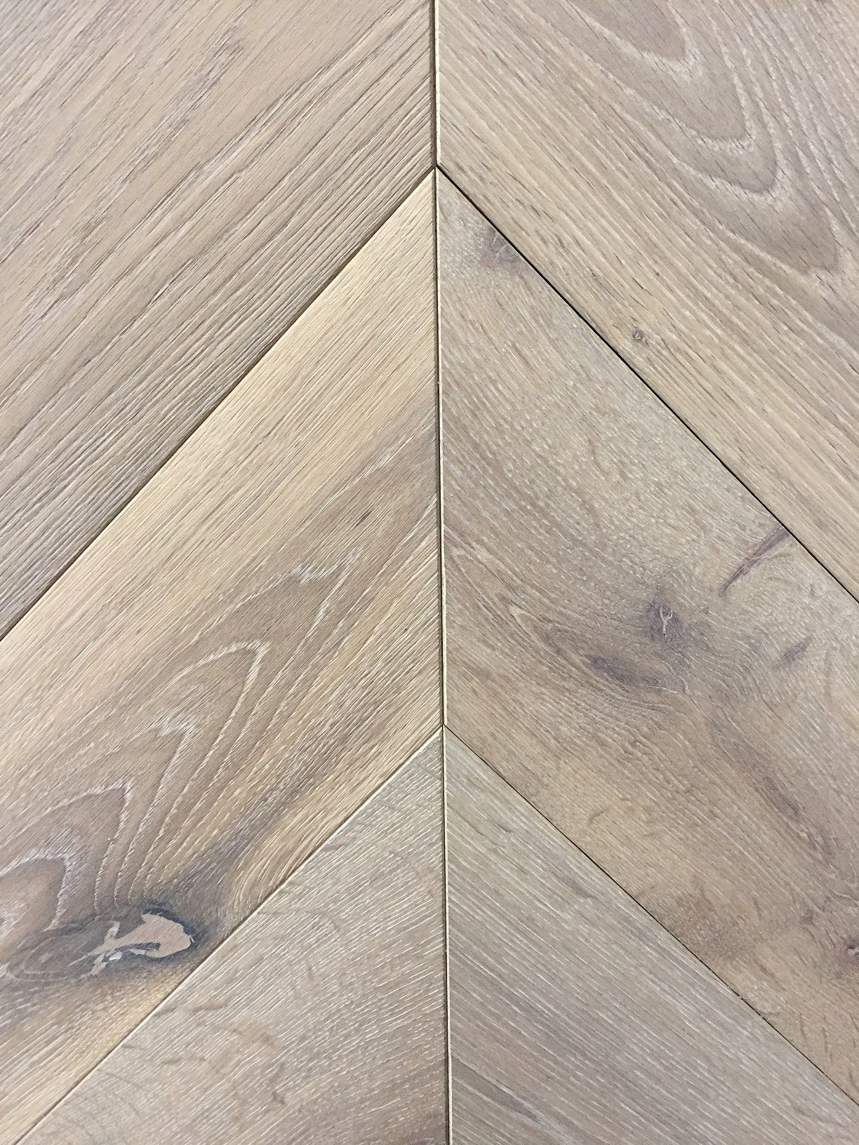 SILVER GREY  Chevron engineered oak parquet flooring  Light Brushed     Chevron engineered oak parquet flooring  Light Brushed  Special treatment   grey oil  Free engineered wood samples sent daily  Wood flooring delivery  within