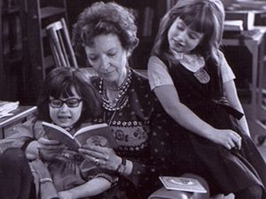 Madeleine L'Engle reading to her granddaughters.