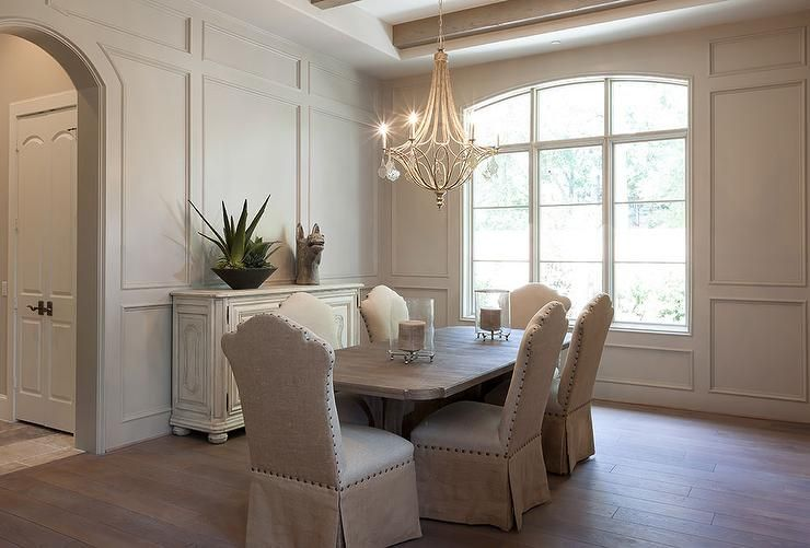 Elegant Dining Room Features Walls Clad In Wainscoting Surrounding