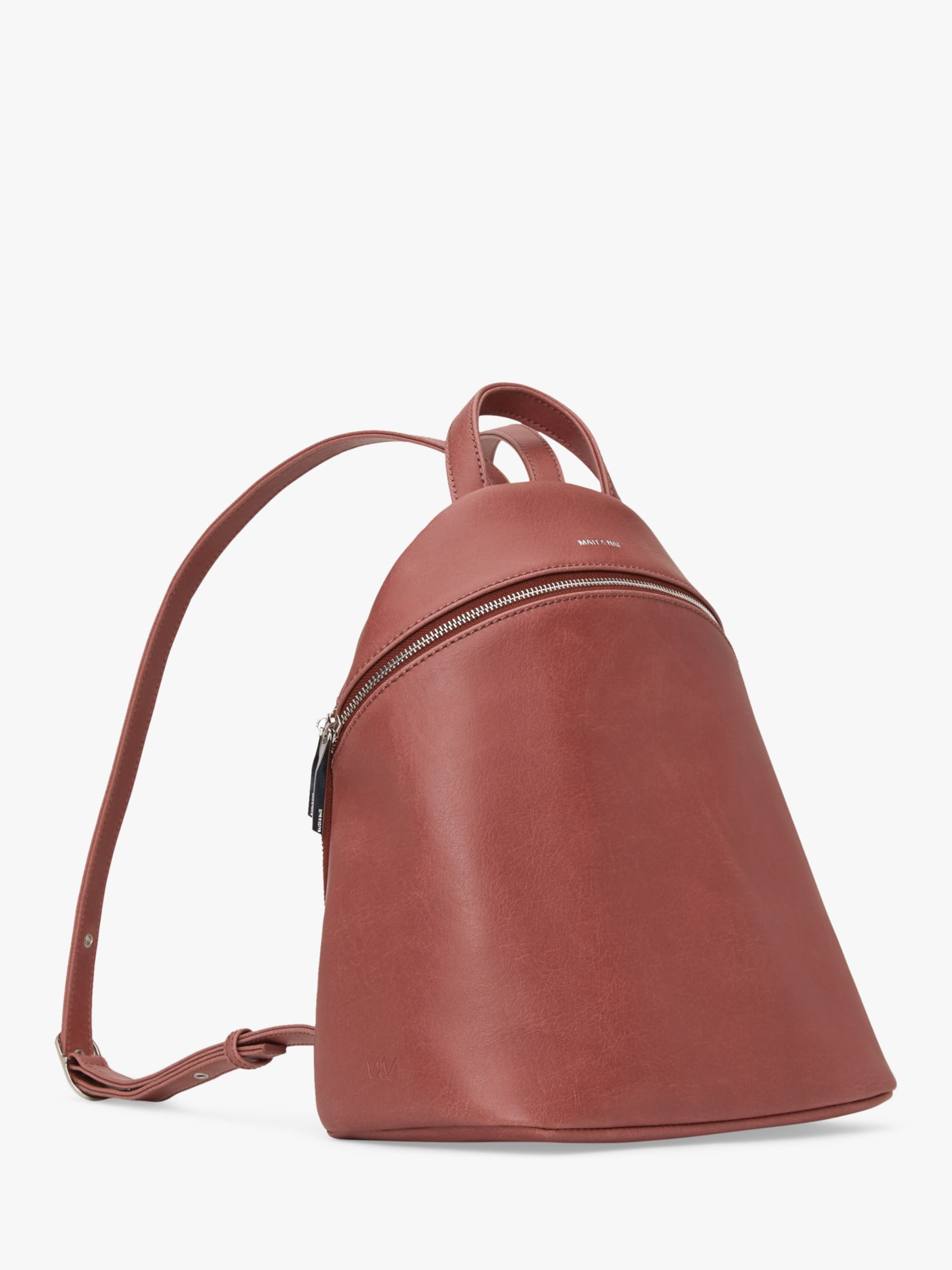 Perfect for busy city commutes, this Aries backpack from the Matt & Nat Vintage Collection has a sleek, smooth finish for a modern appeal. Composed of synthetic material that is completely free from animal-based materials, the faux leather design secures with a curved zip fastening at the top. The bag opens to reveal a zipped and a smartphone pocket to help keep you organised. It also comes with a handy back pocket for travel passes and frequently used items. It is completed with subtle branding