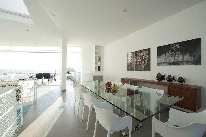 Casa En Las Palmerasriofriorodrigo Arquitectos  Penthouses Extraordinary Large Glass Dining Room Table Decorating Design