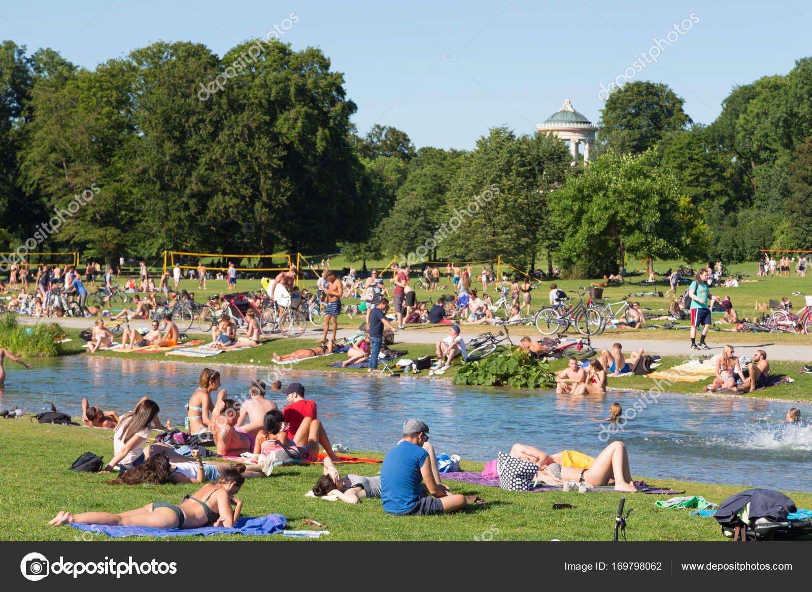 People Enjoying The Summer Day In Englischer Garten City Park In Park City Park City