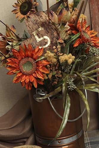 Make sure to add your own personal touches to your decor.  Handpainted bark and rustic floral arrangements make a very nice centerpiece. #CarlsonCraft