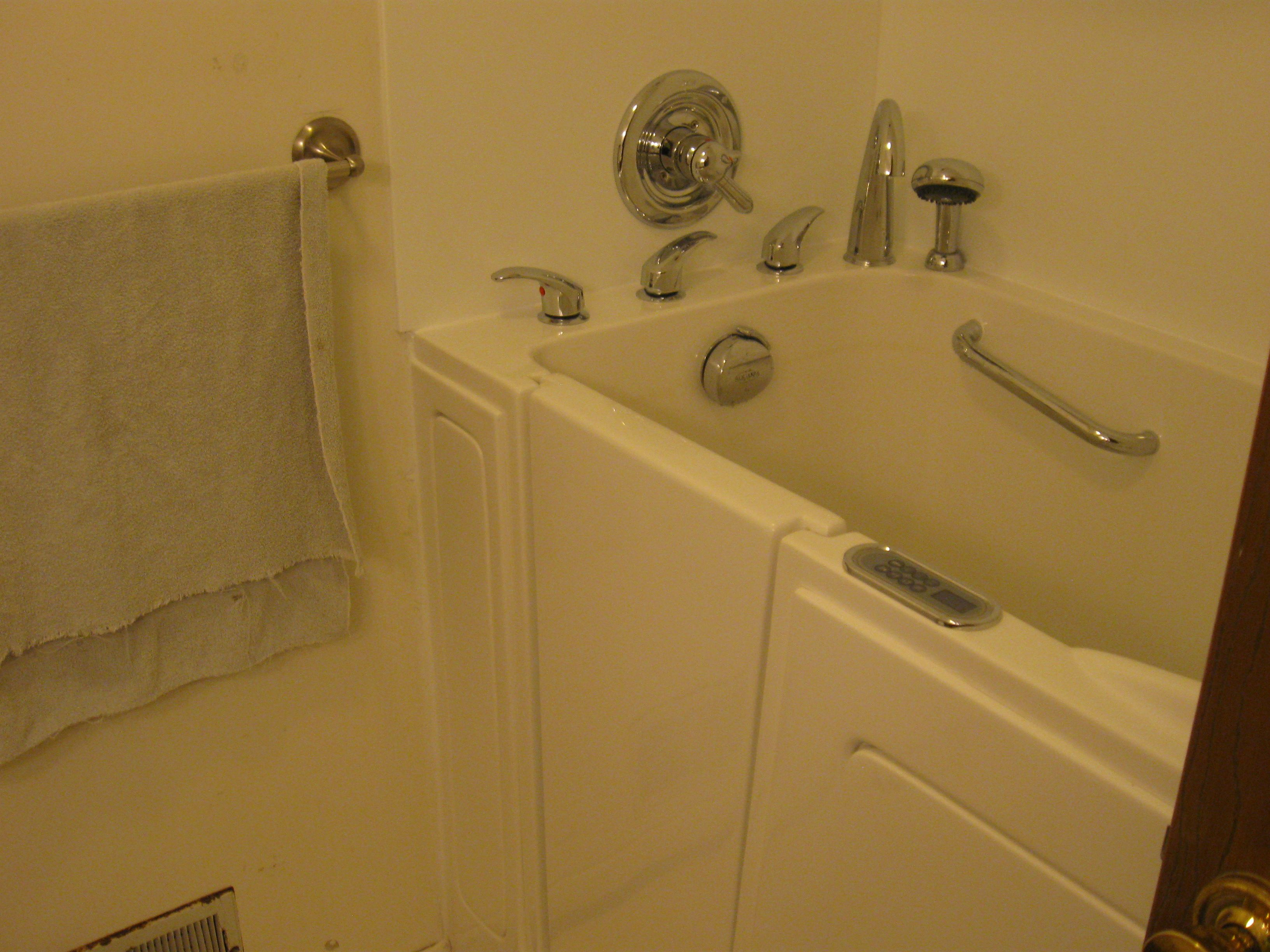 Walk in tub with an Avonite shower wall surround | Universal Builds ...