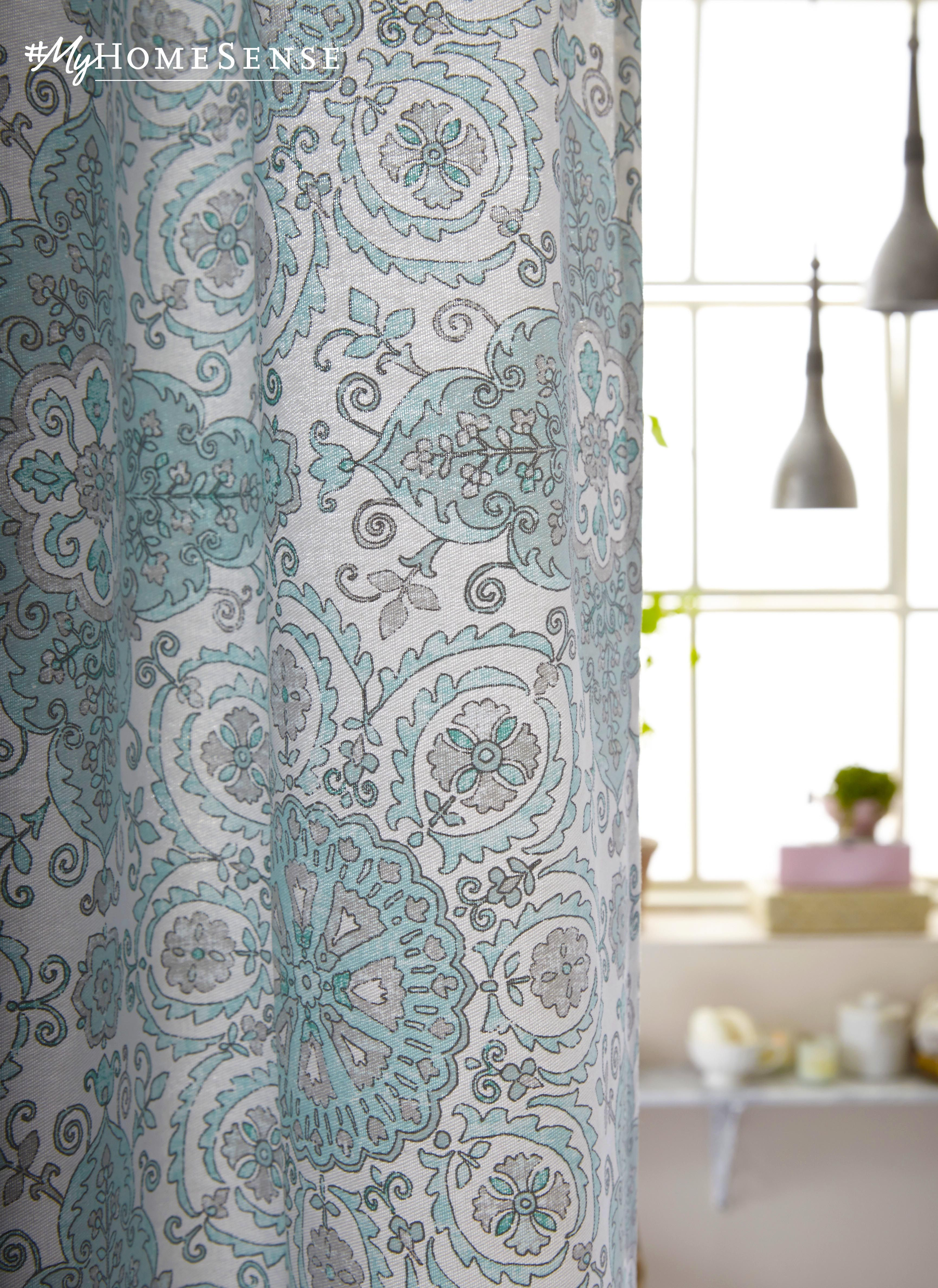 A powder blue heirloom shower curtain to create instant charm in