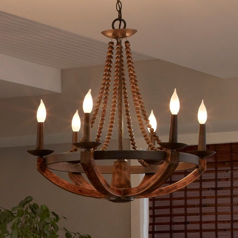 Rustic iron burnished wood sculpted wood beads 3 light6 light this sculpted wood beads candelabra chandelier will bring in a welcoming farmhouse feel to any space aloadofball Images