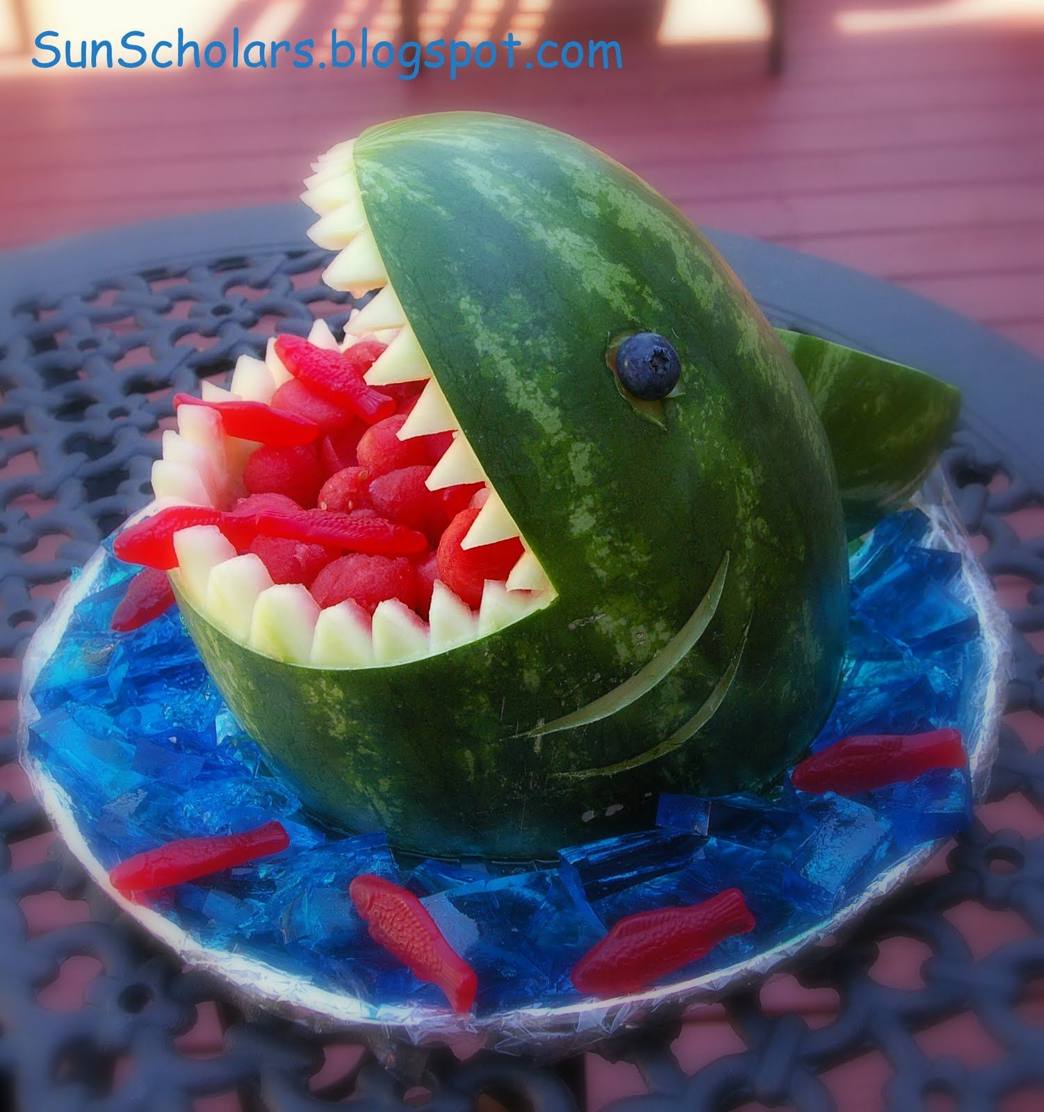 shark watermelon w blue jello water and swedish fish ...