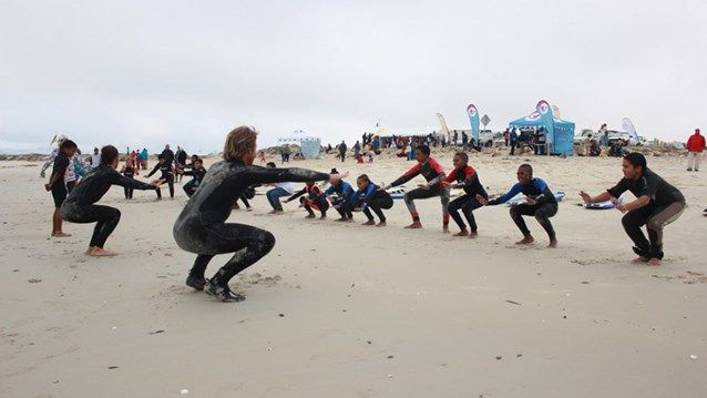 Volunteering for a surf school in South Africa - Teaching local kids how to surf #travel #kilroy #beach #helping #africa #SouthAfrica