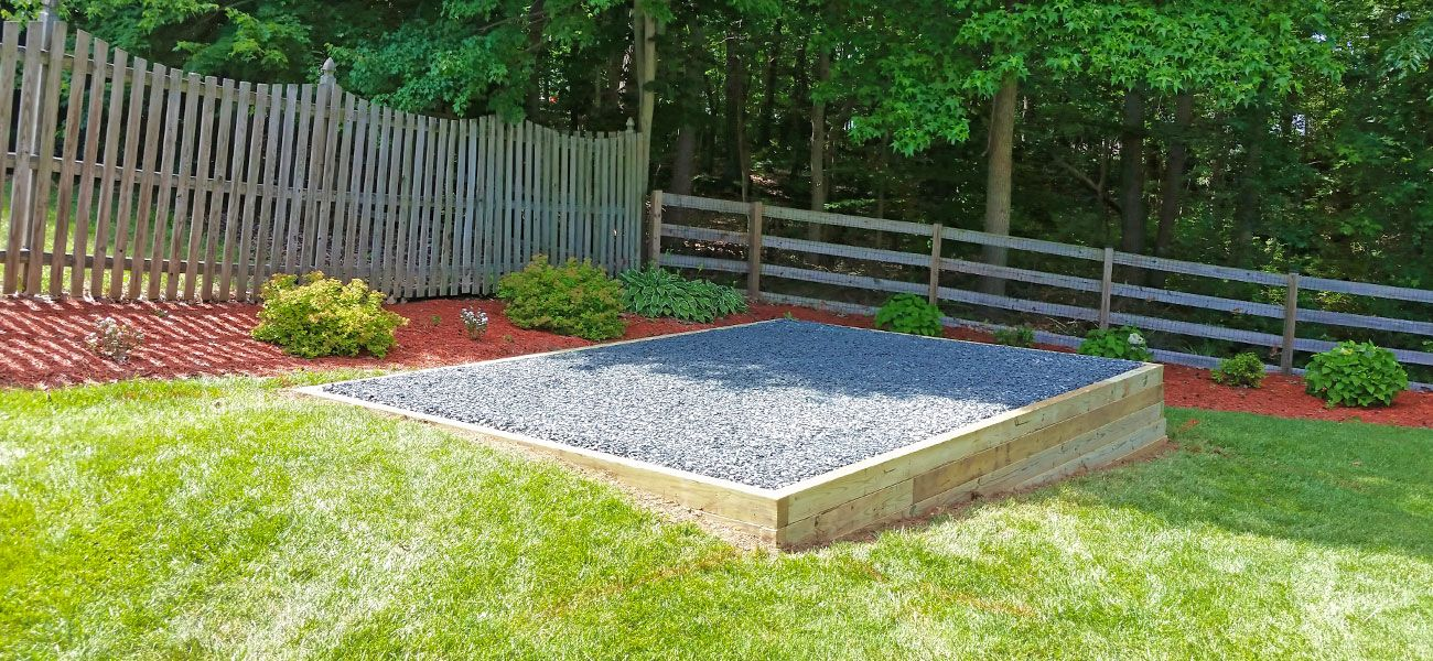 Gravel pad for shed foundation shed base site