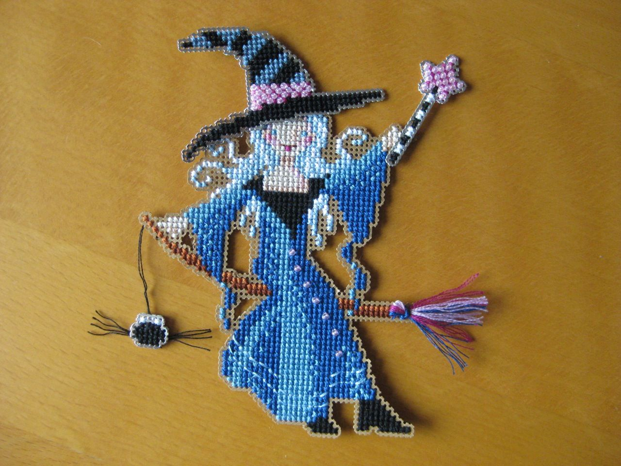 A Halloween ornament from a 'Brooke's Books' design - cross stitch on perforated paper