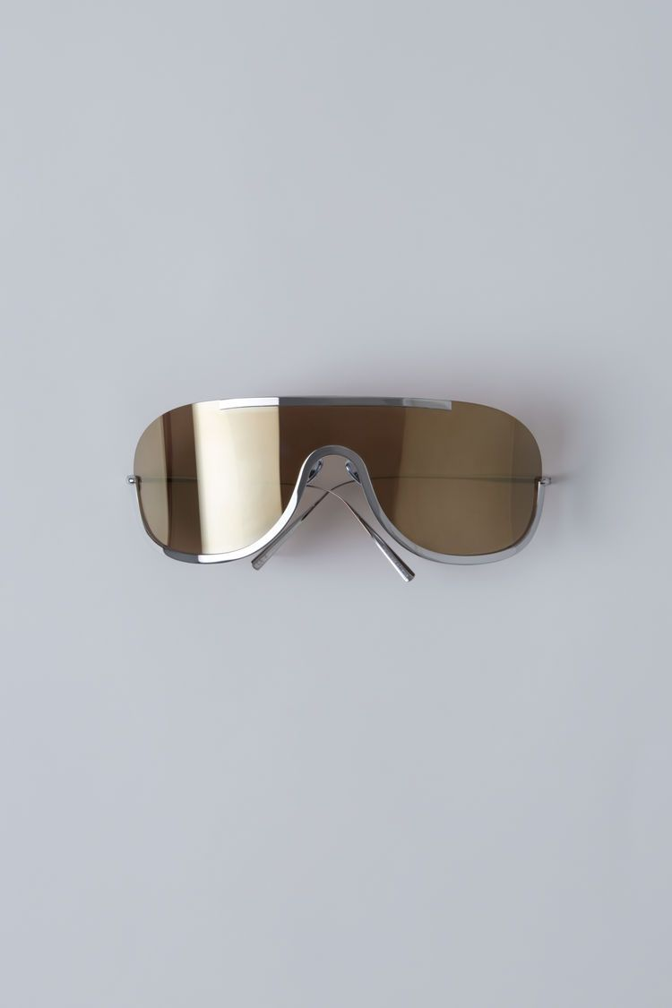 Acne Studios Mask junior gold silver is the smaller version of Mask. They  feature an oversized, sporty, futuristic design. f281e3cbfc2